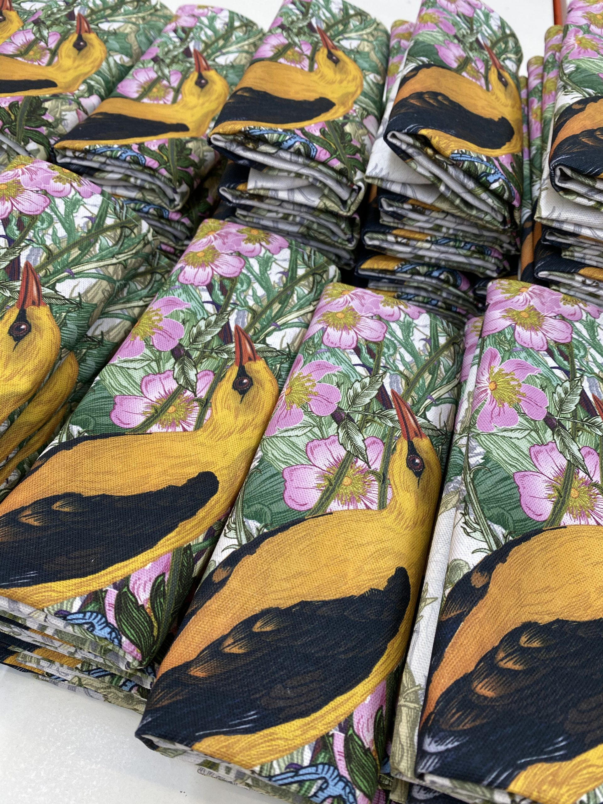 Digitally printed tea towels folded ready for a belly band at Paul Bristow's