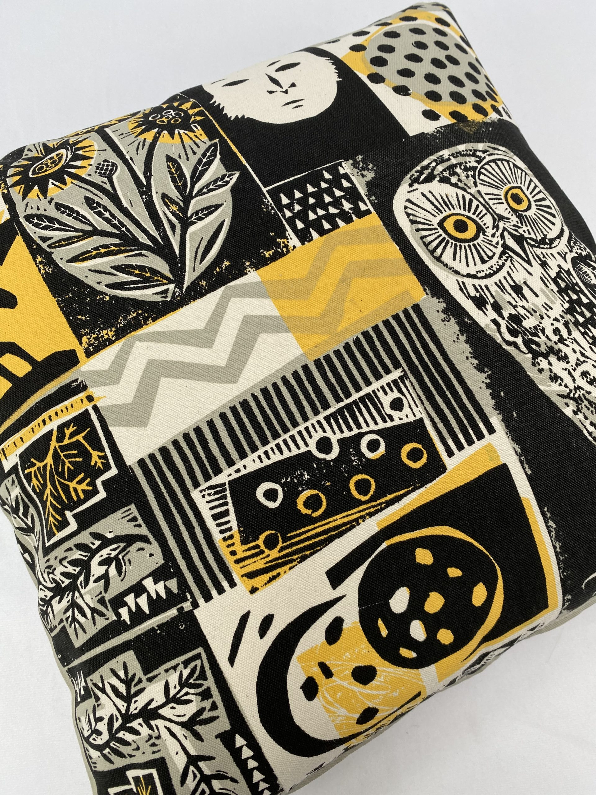 Screen printed textile merchandise including cushion covers by Pul Bristow designed by Mark Herald for Tate