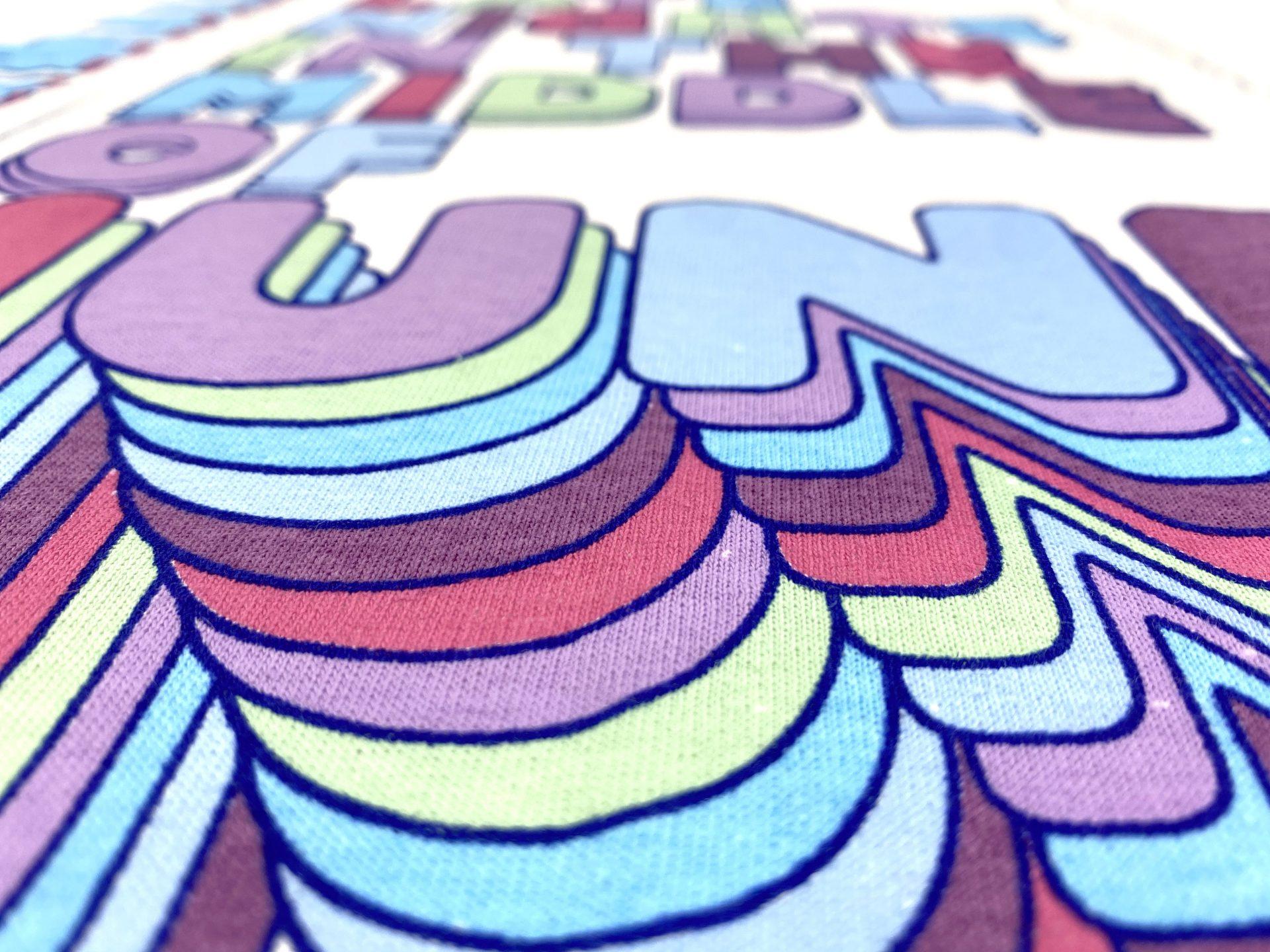 Close up of screen printing onto a Gildan Heavy t-shirt