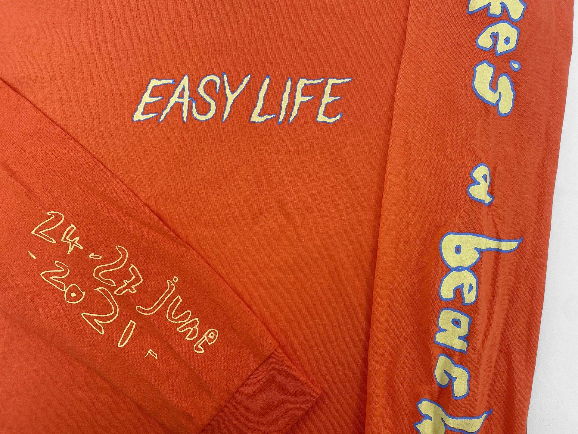 Orange Easy Life screen printed back using water based inks
