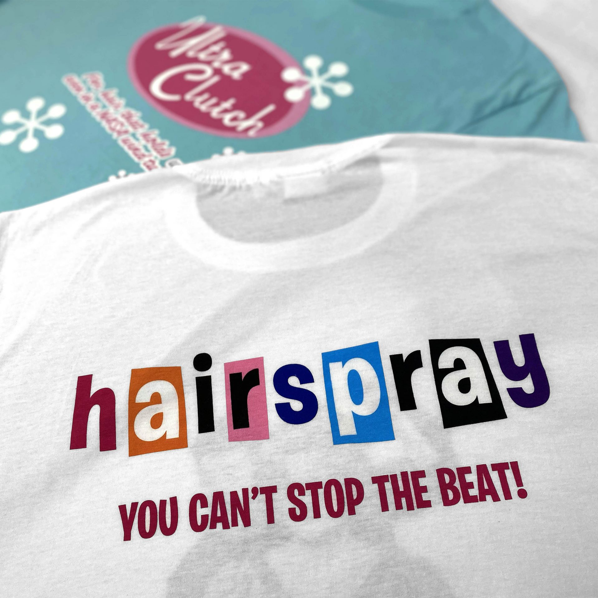 Back print and front print of two Hairspray screen printed t-shirts