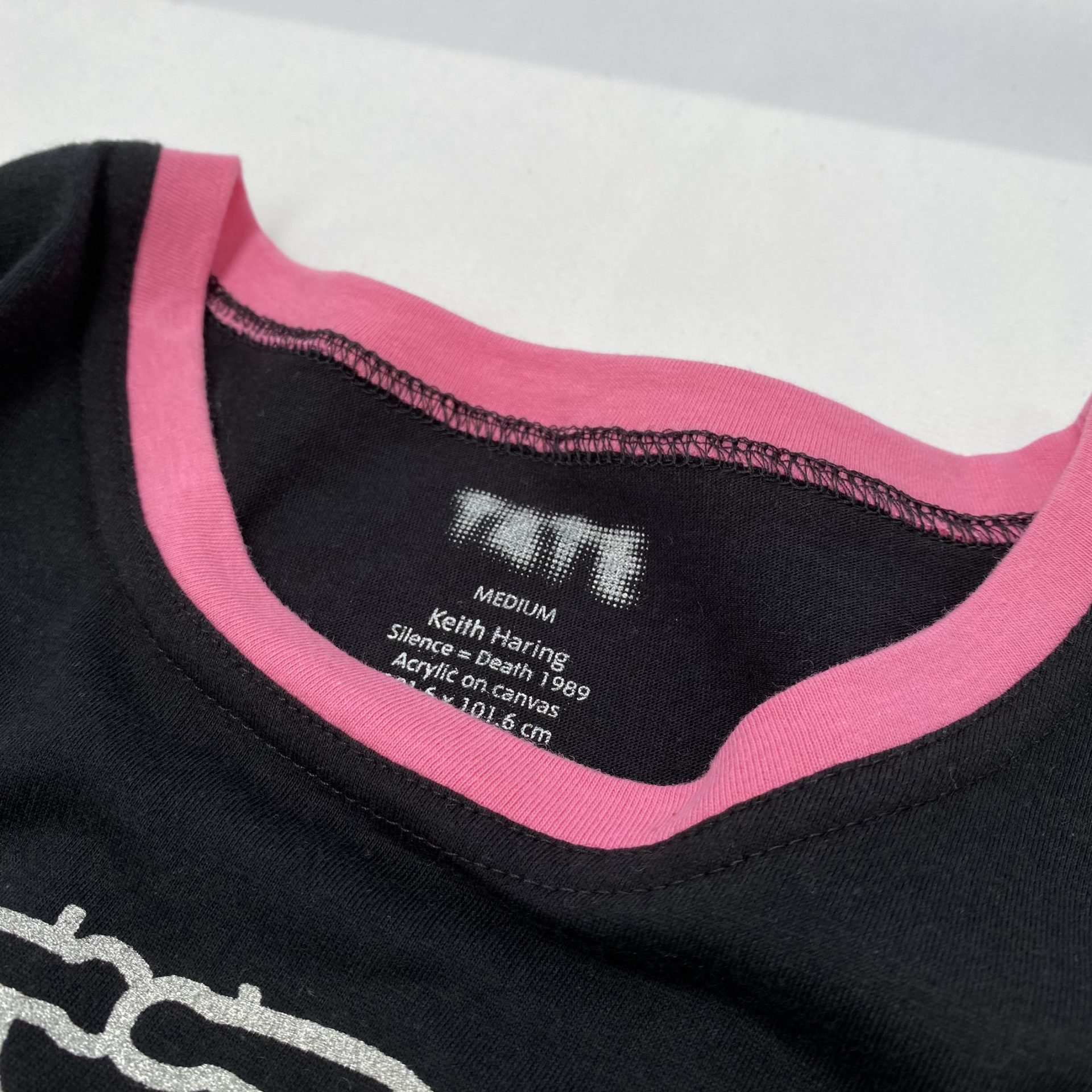 Bespoke adjustment to a t-shirt by Paul Bristow's who supply cultural attractions with textile merchandise
