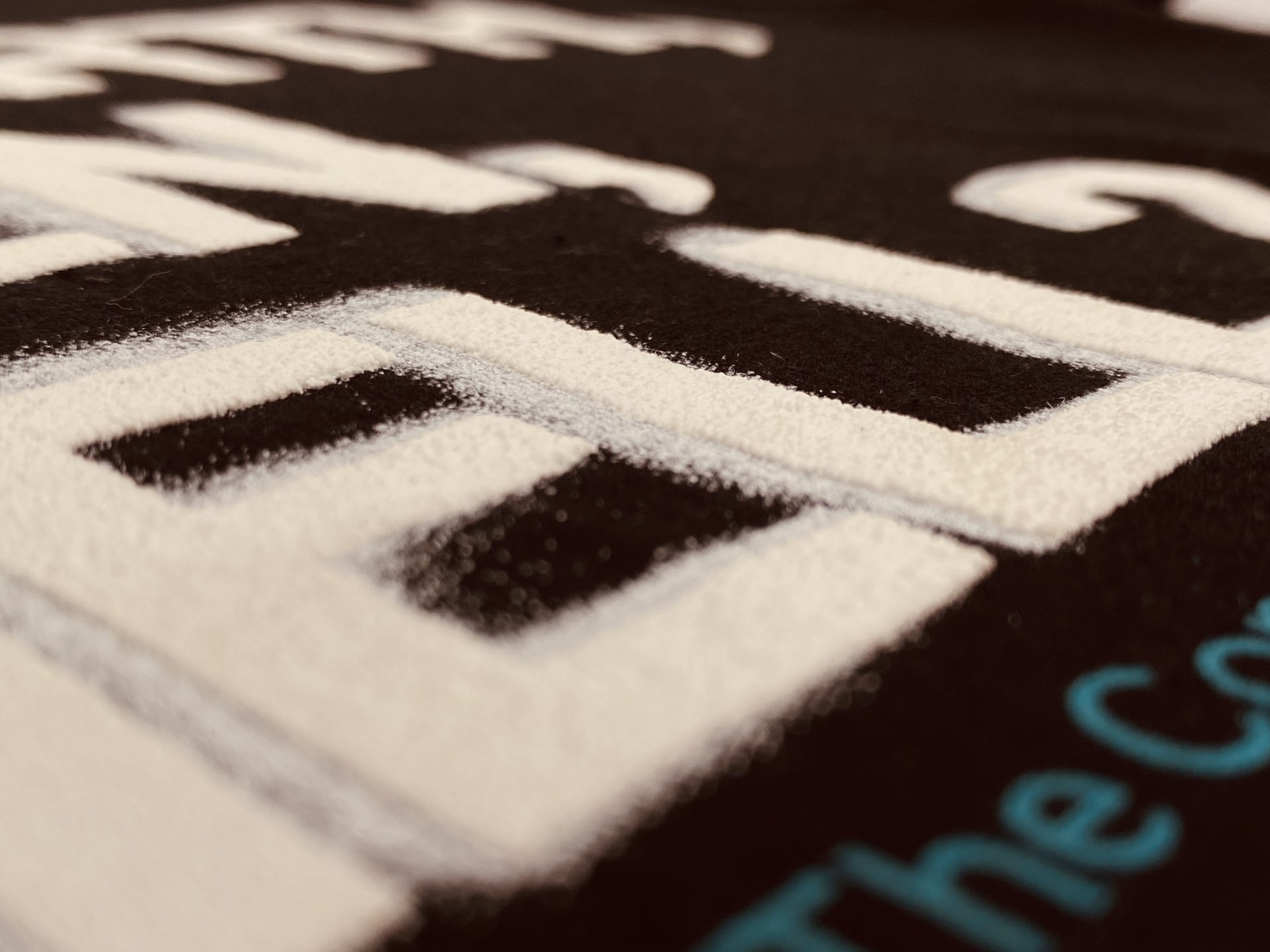 Close up of exapndng or puff ink on a printed t-shirt by Paul Bristow