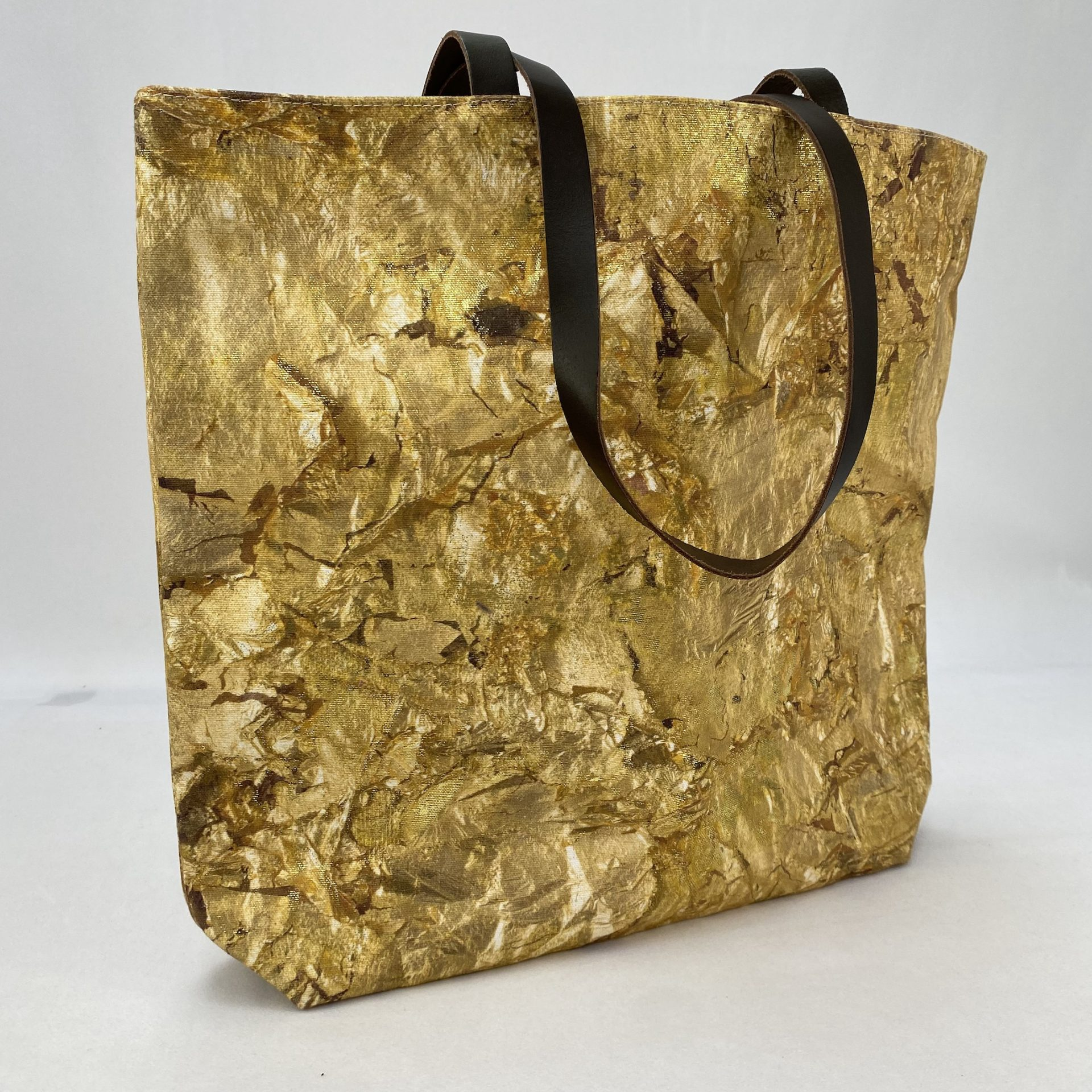 Innovative gold foil printing onto a digitally printed tote bag of a Rauschenberg artwork for the Tate