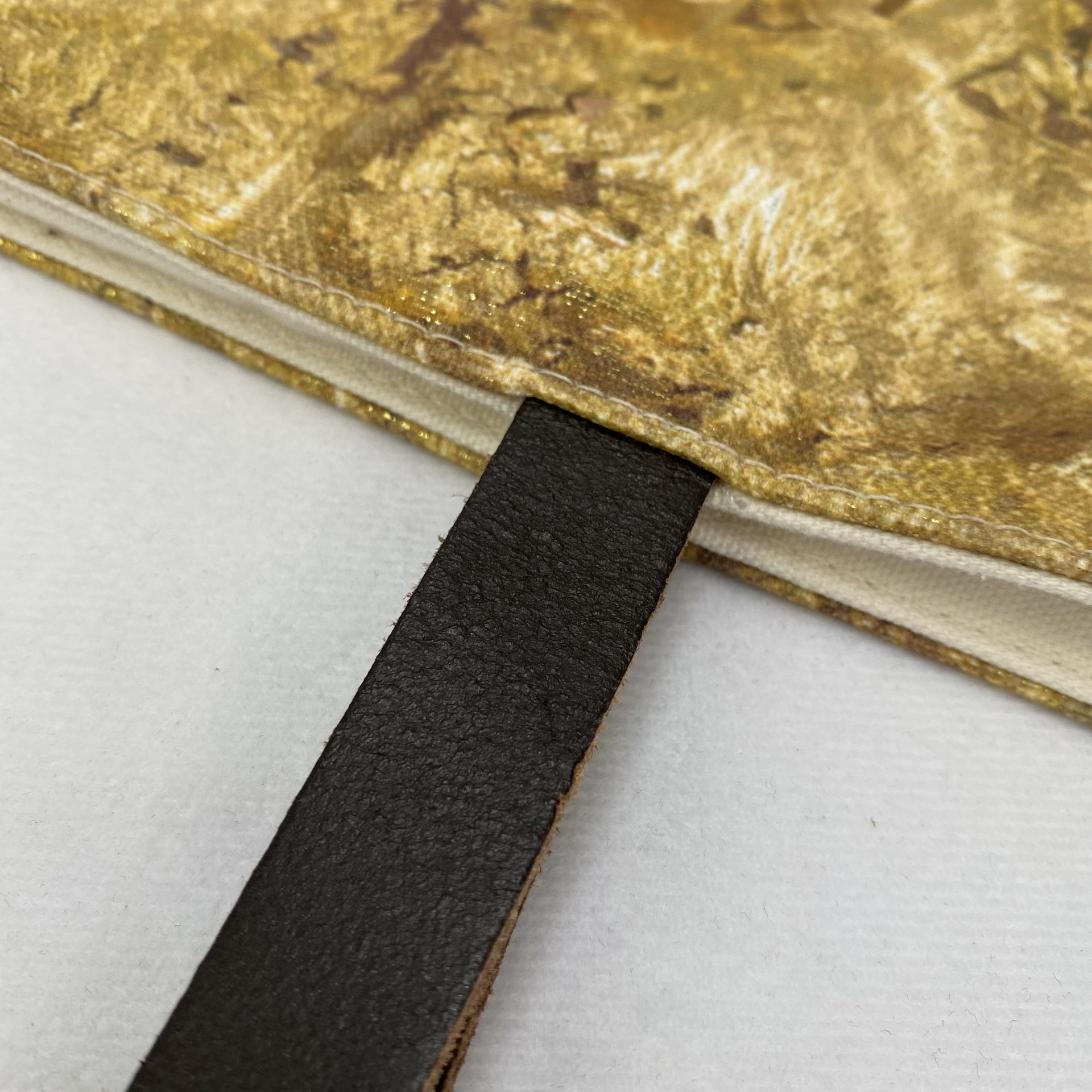 Leather handles on a luxury bag with innovative foil printing by Paul Bristow's for the Tate