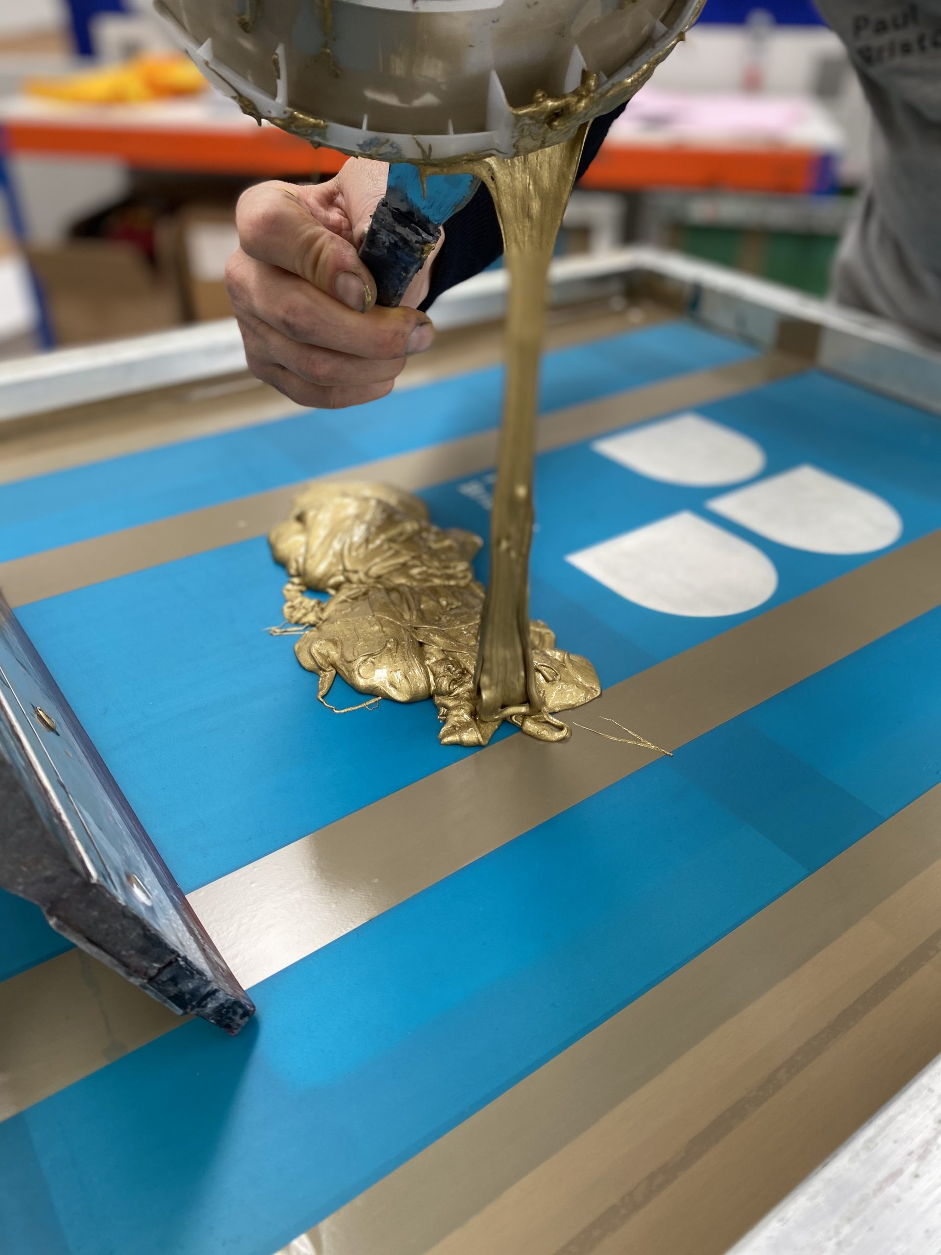 Metallic ink being put into a Paul Brisotw branded screen