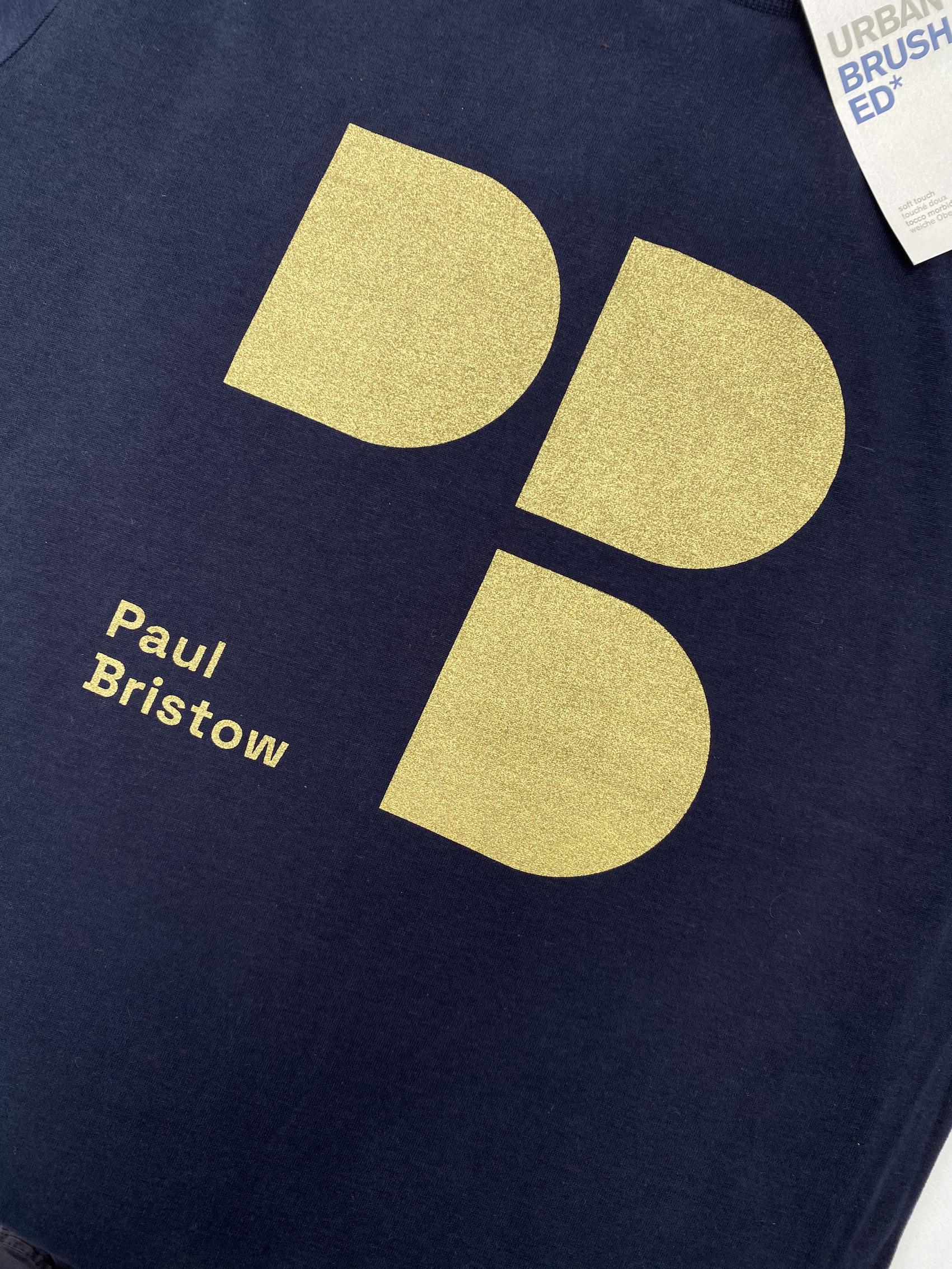 Paul Bristow logo on printed t-shirts in gold metallic ink