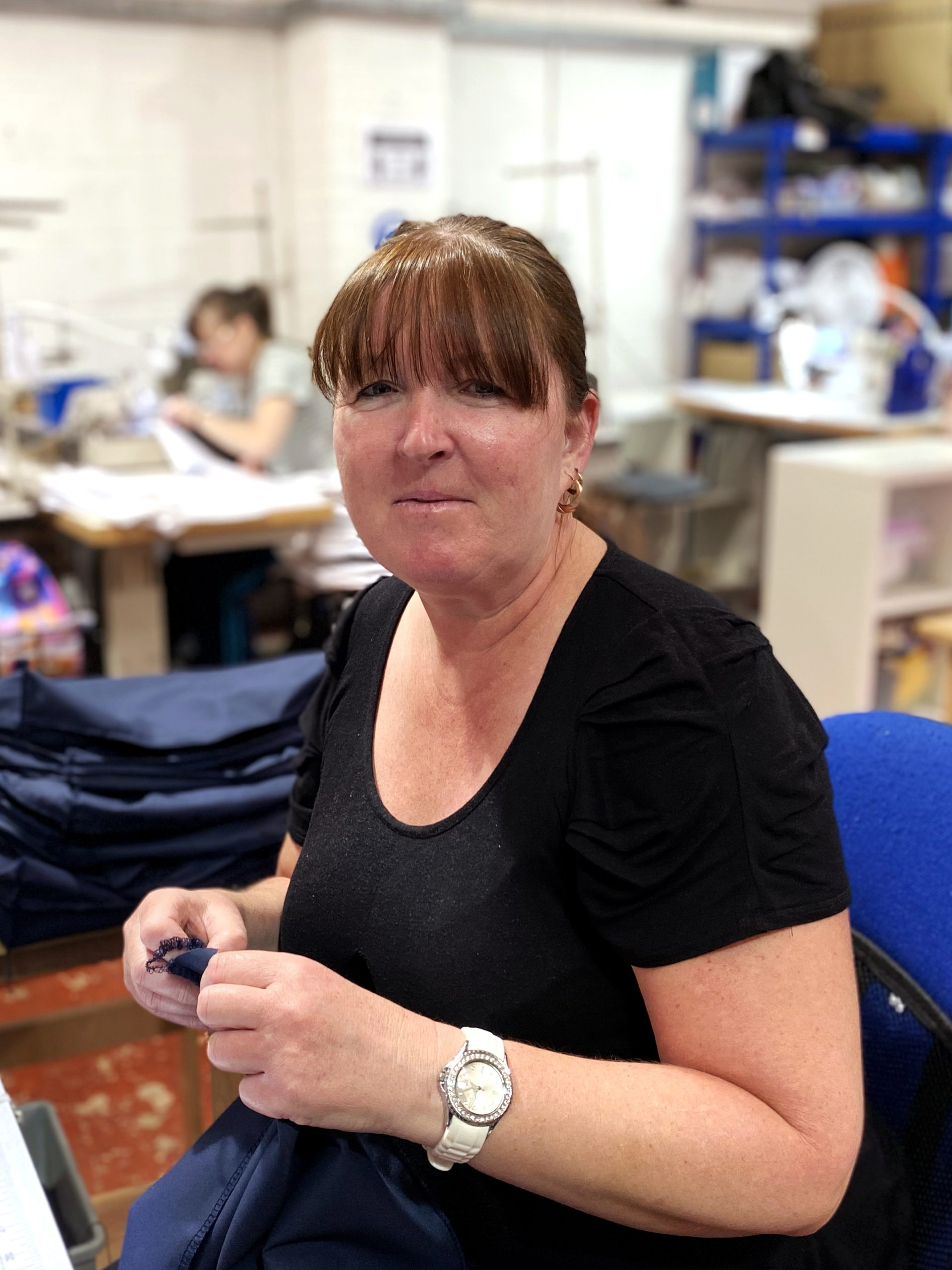 Sharon sitting in the sewing department, wrexham, UK